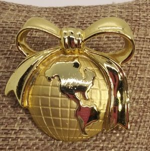 AJC Gold Toned Globe With Bow Brooch